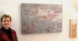 "Martha Rea Baker with her encaustic, ""Alchemy VII--Purity"""